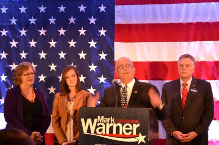 Rep. Gerald E. Connolly (center), flanked by his wife, Cathy (far left), his daughter, Caitlin (left), and Virginia Gov. Terry McAuliffe (right), during his 2014 victory speech. (Warren Rojas/CQ Roll Call)