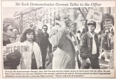 Former Rep. Bob Dornan chats on his cellphone in 1990.