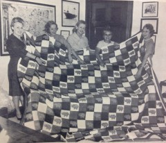 "The ladies of the ""Old Fashion Republican Quilting Party"" pose with their quilt."