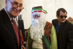 "Schumer, left, and Nader Moavenian, center, who is dressed as ""Uncle Nowruz."" (Photo By Tom Williams/CQ Roll Call)"