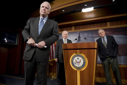 Lieberman and Kyl stand behind Sen. John McCain in a 2010 news conference about sanctions on Iran (CQ Roll Call File Photo0.