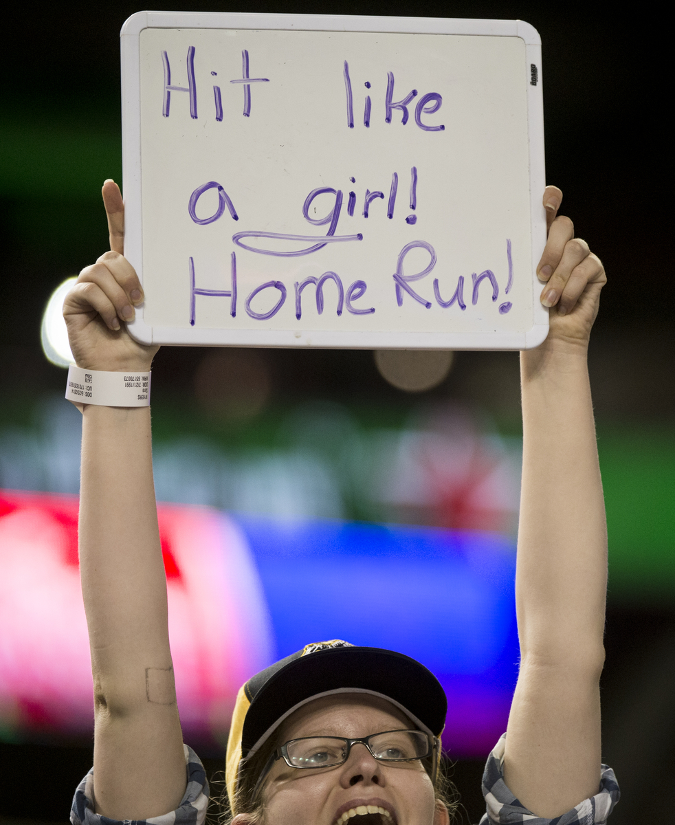 UNITED STATES - JUNE 25: A fan of Rep. Linda Sanchez, D-Calif., cheers as Sanchez bats during the Roll Call Congressional Baseball Game on Wednesday, June 25, 2014. (Photo By Bill Clark/CQ Roll Call File Photo)