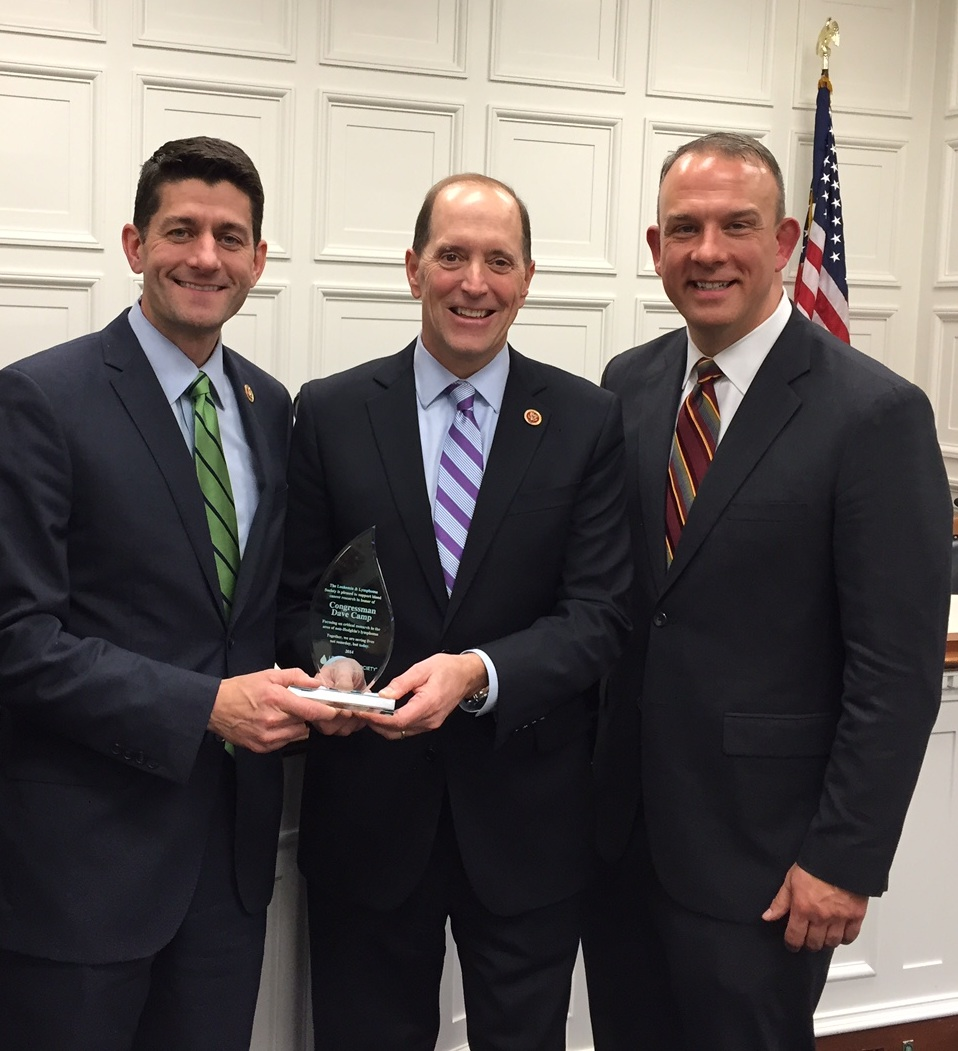 Rep. Paul Ryan (left), R-Wis., joins retiring Rep. Dave Camp (center), R-Mich., and Camp chief of staff Jim Brandell (right) in commemorating the new research grant Brandell created in Camp's honor to distribute all the money raised for the Leukemia & Lymphoma Society. (Courtesy Leukemia & Lymphoma Society)