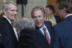 UNITED STATES - DECEMBER 3 - Former President George Bush greets congressmen, including Sen. Rob Portman, R-Ohio, left, after the unveiling of former Vice President Dick Cheney's marble bust in the Emancipation Hall on Capitol Hill in Washington, Thursday, Dec. 3, 2015. Congressional leaders and former President George W. Bush paid tribute to Cheney, who also served as congressman from Wyoming. (Photo By Al Drago/CQ Roll Call)