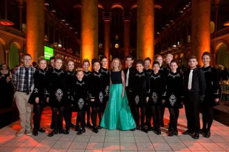 Irish step dancers pose with Irish Ambassador Anne Anderson.