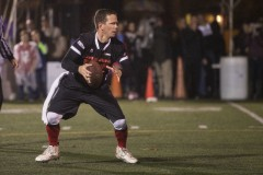 UNITED STATES - OCTOBER 28 - Captain Rep. Robert Dold, R-Ill., looks for an open man to pass the ball to during the eighth annual Congressional Football Game for Charity, on Capitol Hill in Washington, Wednesday, October 28, 2015. (Photo By Al Drago/CQ Roll Call)