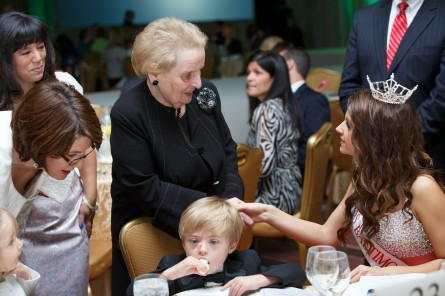 Former Secretary of State Madeleine Albright, center, talks with Olivia Dumer, the 2013 Miss Baltimore's Teen winner. Rep. McMorris Rodgers, left, checks on her son Cole, seated.