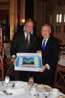 Moran and McConnell pose with a commemorative cake before a Senate Republican lunch. (Courtesy Office of Sen. Jerry Moran)