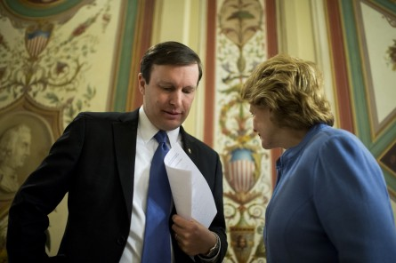 Miriam's Kitchen is mighty impressed with Murphy, left. (Bill Clark/CQ Roll Call File Photo)