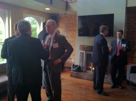 Foster, center, chats with business advocates Thursday evening. (Julie Ershadi/CQ Roll Call)