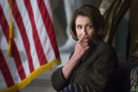 UNITED STATES - MARCH 2 - House Minority Leader Nancy Pelosi, D-Calif., signals a member of her staff for her notes during a presentation to honor women veterans for their service, in Statuary Hall on Capitol Hill, Wednesday, March 2, 2016. (Photo By Al Drago/CQ Roll Call)